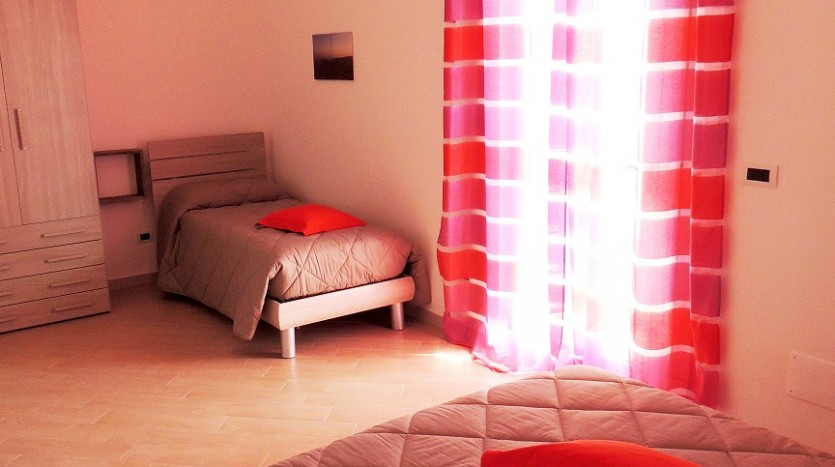 I colori caldi della camera Tramonto a Villa Simone